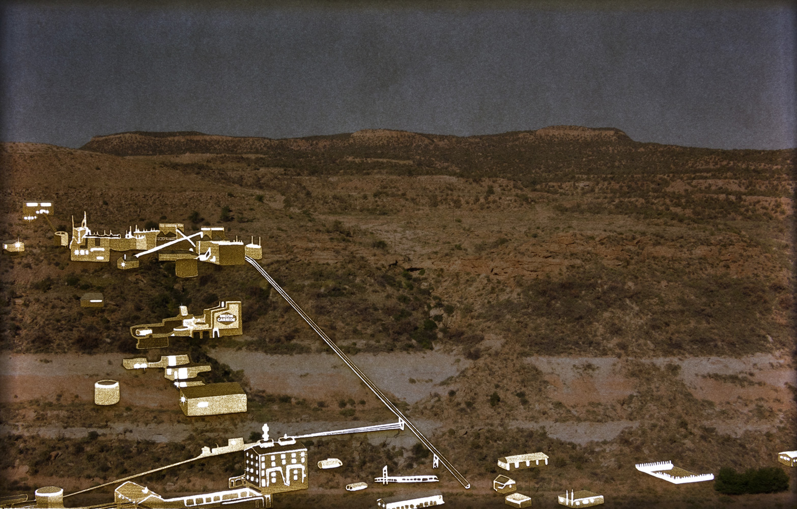 Gritty, darkened image of arid landscape with built structures burnt and cut into the surface and appearing in brown or backlit white.